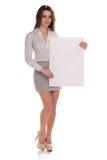 有空白董事会的新愉快的妇女 免版税库存照片