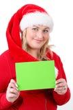 有空的符号的快乐的俏丽的圣诞老人妇女 免版税库存图片