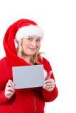 有空的符号的快乐的俏丽的圣诞老人妇女 免版税图库摄影