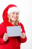 有空的符号的快乐的俏丽的圣诞老人妇女 图库摄影