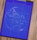 有笔图纸的男性手 行星 库存图片