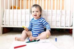 有笔的可爱的婴孩 库存图片