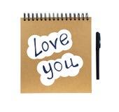 有笔的我爱你和笔记本 免版税库存照片