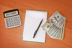 有笔的,计算器笔记本 免版税图库摄影