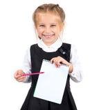 有笔记本的女小学生 免版税图库摄影