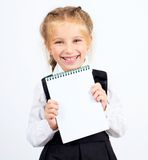 有笔记本的女小学生 库存图片