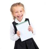 有笔记本的女小学生 免版税库存照片