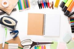 有笔记本的学校设备 免版税库存照片
