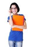 有笔记本的愉快的学员妇女 免版税库存图片