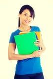 有笔记本的愉快的学员妇女 免版税库存照片