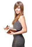有笔记本的美丽的少妇 免版税库存图片