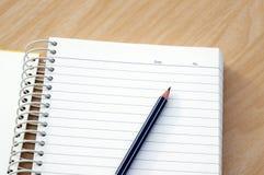 有笔记本的铅笔 免版税图库摄影