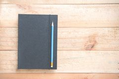 有笔记本的铅笔 库存图片
