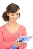 有笔记本的年轻可爱的女实业家 免版税图库摄影