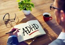 有笔记薄和ADHD概念的商人 免版税图库摄影