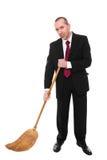 有笤帚的商人 免版税库存图片