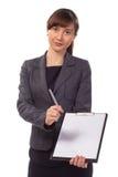 有签合同的剪贴板提议的俏丽的女实业家 免版税库存照片