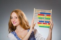 有算盘的少妇在学校 免版税库存照片