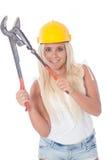 有管子钳子的女工 免版税库存图片