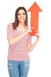 有箭头的年轻偶然妇女 免版税库存照片
