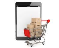 有箱子的购物车临近片剂个人计算机 库存照片