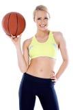 有篮子球的可爱的女孩 图库摄影