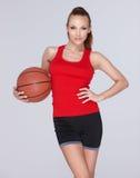 有篮子球的妇女 库存照片