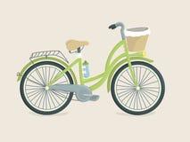 有篮子的逗人喜爱的绿色自行车 皇族释放例证
