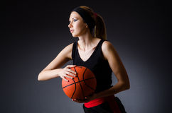 有篮球的妇女在体育概念 免版税库存图片