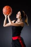 有篮球的妇女在体育概念 免版税图库摄影