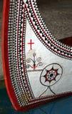 有精心制作的装饰的部族独木舟 免版税库存图片