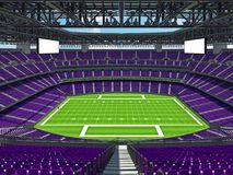 有紫色位子的现代橄榄球体育场 库存照片