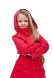 有红色外套的美丽的小女孩 免版税图库摄影