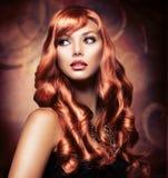 有红色头发的女孩 免版税图库摄影