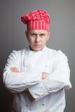 有红色帽子的厨师 库存图片