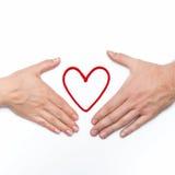 有红色心脏的两只手 库存照片