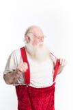 有红色悬挂装置的笑的圣诞老人 库存图片