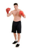 有红色手套的男性拳击手 库存图片