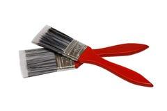 有红色把柄的两把油漆刷 免版税图库摄影