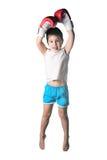 有红色拳击手套胜利跃迁的小男孩在被隔绝的白色背景 免版税库存照片