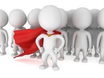 有红色斗篷的勇敢的超级英雄在人群面前 免版税图库摄影
