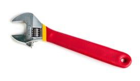 有红色橡胶处理的把柄的可调扳手 免版税库存图片