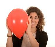 有红色气球的妇女 库存照片