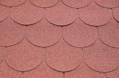 有红色沥清的屋顶盖特写镜头 库存图片
