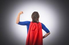有红色海角的妇女超级英雄,被隔绝 免版税库存照片