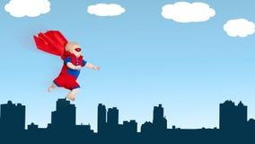 有红色海角飞行thro的小孩小小超人超级英雄 库存图片