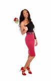 有红色玫瑰的女孩 免版税库存照片