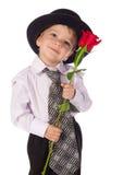 有红色玫瑰的小男孩 免版税库存图片