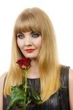 有红色玫瑰的美丽的小姐 库存照片