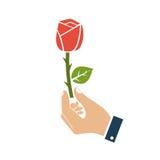 有红色玫瑰象的手 库存照片